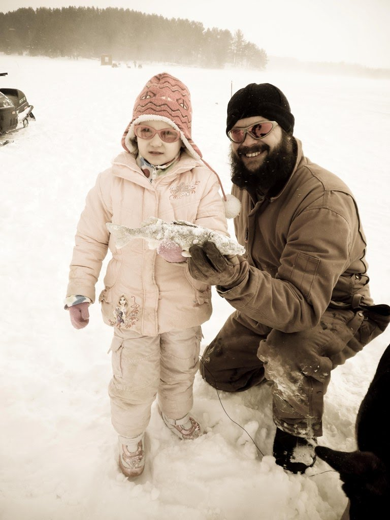 Blogger Brian Johnson poses with his 5 year old daughter and her catch.